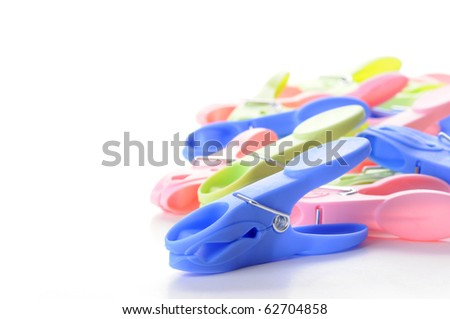Closeup of colorful plastic clothespins with room for text.