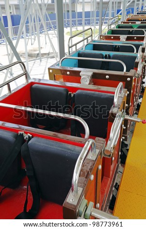 Closeup of colorful roller coaster cab in an amusement park. - stock photo