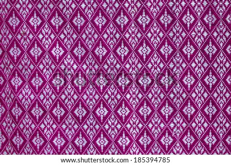 Closeup of colorful striped fabric textile as background texture