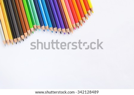Closeup of Colour pencils on white background, selective focus