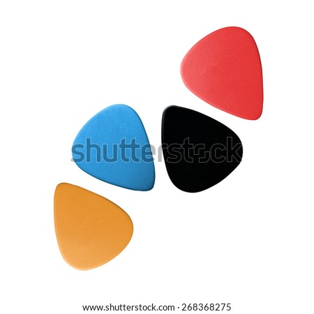 Closeup of 4 colourful plectrums isolated - stock photo