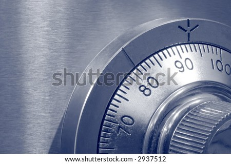 Closeup of combination safe lock ~ blue duotone. - stock photo