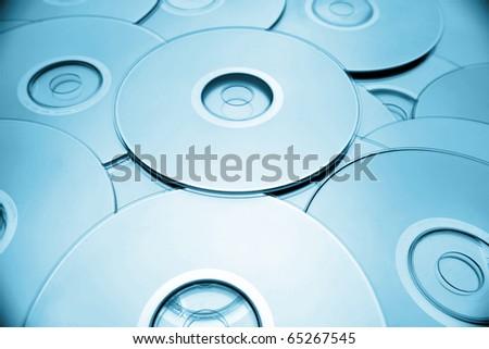 Closeup of compact discs. Blue tone - stock photo