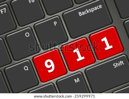closeup of computer keyboard with 911 emergency number