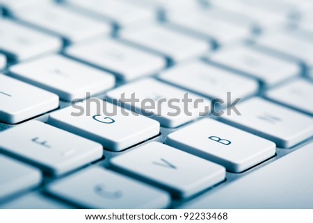 closeup of computer keyboard with shallow depth of field - stock photo