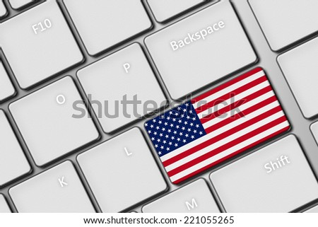 closeup of computer keyboard with United States of America flag button - stock photo