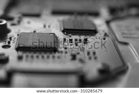 Closeup of computer's hard disk device . black and white photo