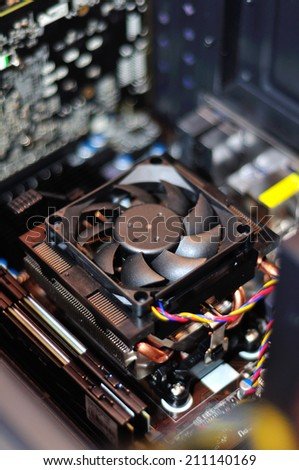 Closeup of computer ventilator with a colorful cables - stock photo