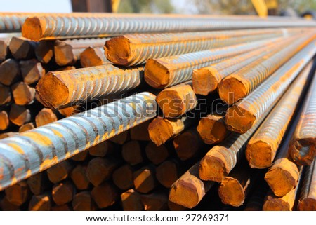 Closeup of concrete reinforcement steel rods in warehouse - stock photo