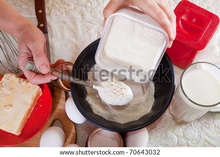 Closeup of cook hands making  dough with flour - stock photo
