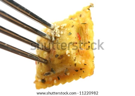Closeup of cooked ravioli on a fork isolated on a white background - stock photo