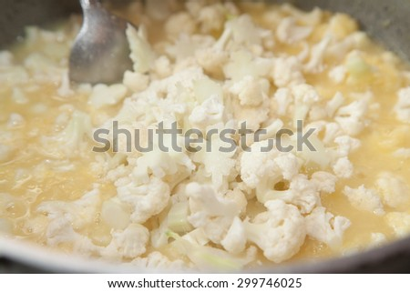 Closeup of cooking soup with cauliflowers  - stock photo