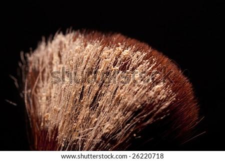 closeup of cosmetic brush on black background - stock photo