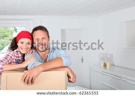 Closeup of couple resting on boxes - stock photo
