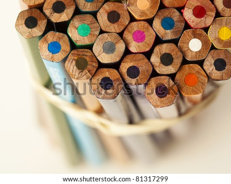 closeup of crayons on glass on white background - stock photo