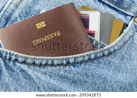 Closeup of credit card and passport in jeans in blue denim jeans pocket