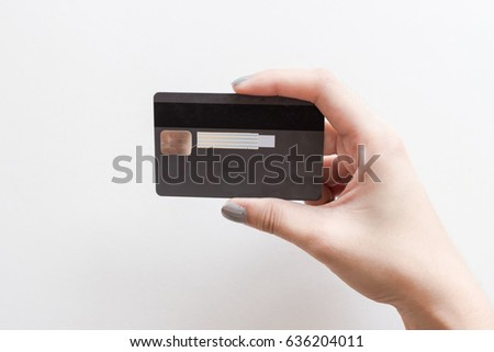 closeup of  credit card holding by hand. credit card in women hand on isolated white background