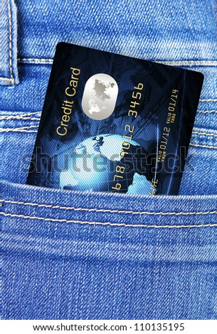 closeup of credit card in jeans trousers pocket - stock photo