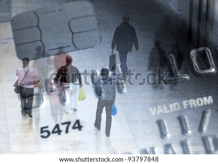 Closeup of credit card overlaid with various shoppers - stock photo