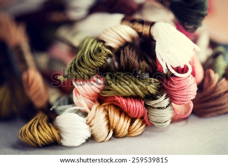 Closeup of cross-stitching skeins with selective focus and shallow depth of field - stock photo