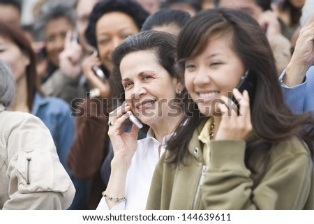 Closeup of crowd using mobile phones - stock photo