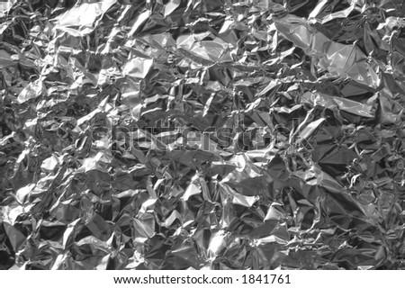 Closeup of crumpled aluminum foil - stock photo