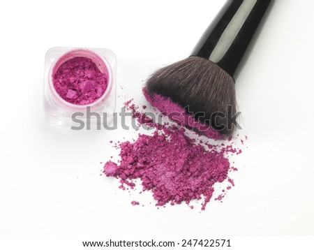 closeup of crushed cosmetics and brush - stock photo
