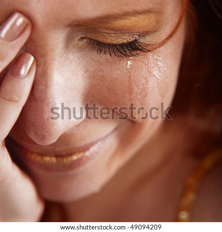 Closeup of crying woman with tears - stock photo