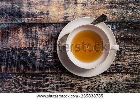 Closeup of cup of tea on vintage wooden background - stock photo
