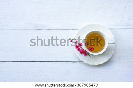 Closeup of cup of tea on wooden table with blur background. Flat lay.still life with tea cup. - stock photo