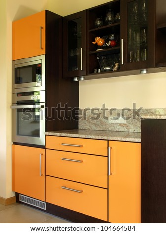 Closeup of cupboards and kitchen appliances, vertical