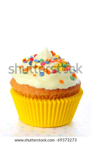 Closeup of cupcake on white isolated background - stock photo