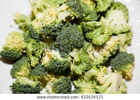 Closeup of cut broccoli heads - stock photo