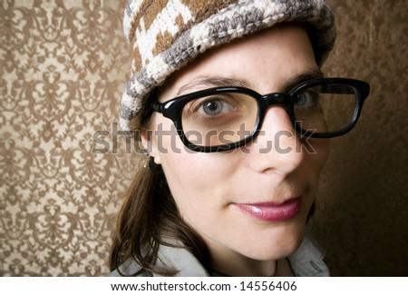 Closeup of Cute Nerdy Woman in a Knit Cap - stock photo