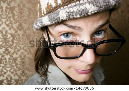 Closeup of Cute Nerdy Woman in a Knit Cap - stock photo