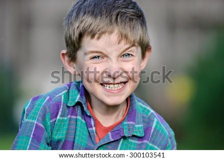 closeup of cute young teen boy smiling - stock photo