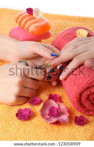 Closeup of cutting fingernails by beautician - stock photo