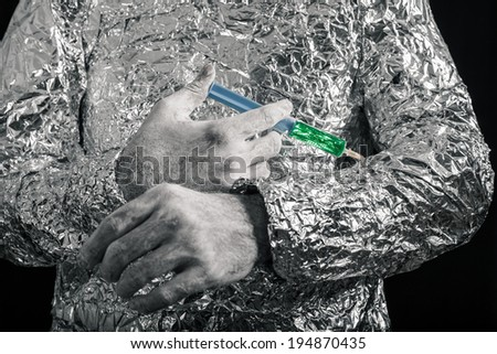 Closeup of cyborg hand applying syringe. - stock photo