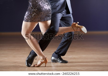 closeup of dancer's legs as they do the tango - stock photo