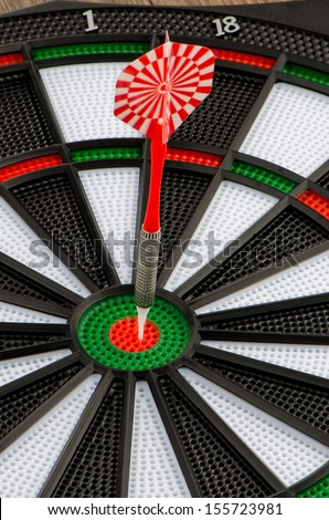 Closeup of dart board with dart.