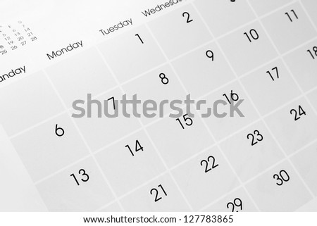 Closeup of dates on calendar page - stock photo
