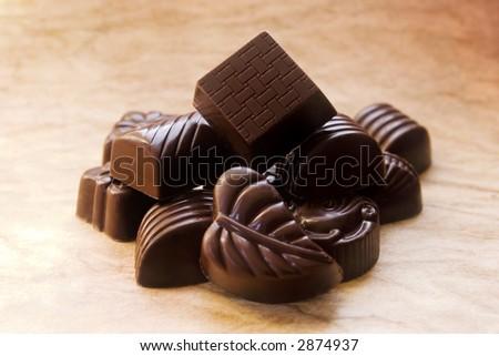 Closeup of decorative dark chocolates - stock photo