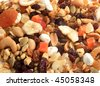 Closeup of delicious and healthy mixed dried fruit, nuts and seeds great for a background - stock photo