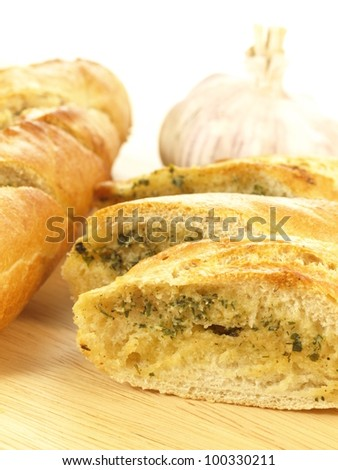 Closeup of delicious baguette with garlic - stock photo