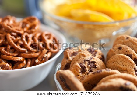 Closeup of delicious cookies and pretzels in bowls, with shallow DOF