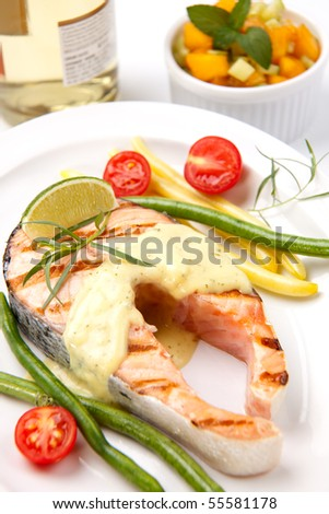 Closeup of delicious grilled salmon steak with tarragon sauce ...