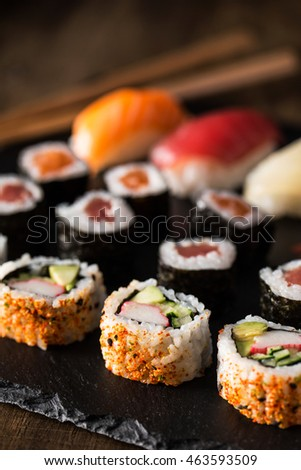 Closeup of delicious maki sushi on a wooden table.