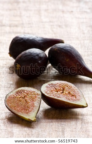 Closeup of delicious organic figs backlit on table with copy space