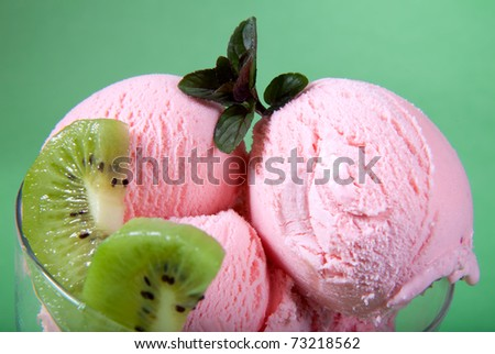 Closeup of delicious Strawberry Ice Cream with fresh kiwi and mint. - stock photo