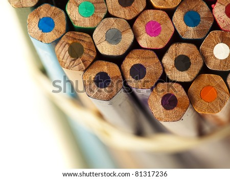 closeup of different crayons on a white background - stock photo